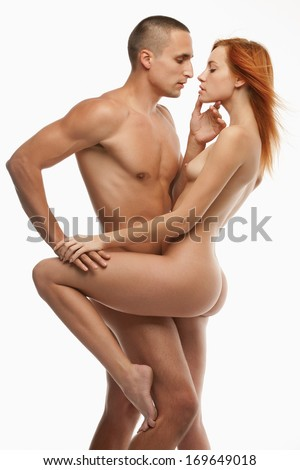 Young sexy naked heterosexual couple making love. Isolated on white background. - stock photo