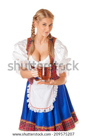 Young sexy Oktoberfest woman wearing a traditional Bavarian dress dirndl serving beer mugs