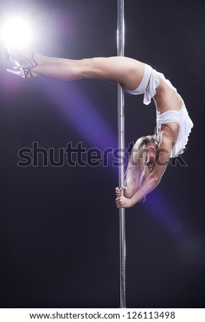 Young sexy pole dance woman.