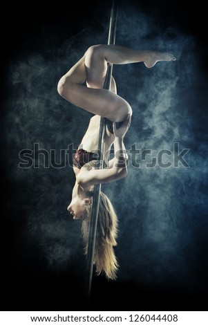 young sexy pole dance woman, dark background