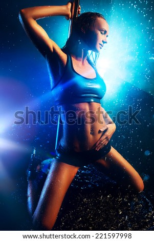 Young sexy pole dance woman with water. - stock photo