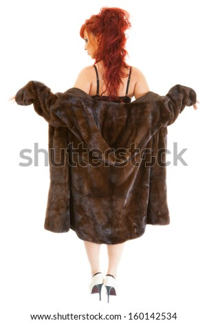 young sexy red-haired woman wearing underwear and  mink fur coat - stock photo