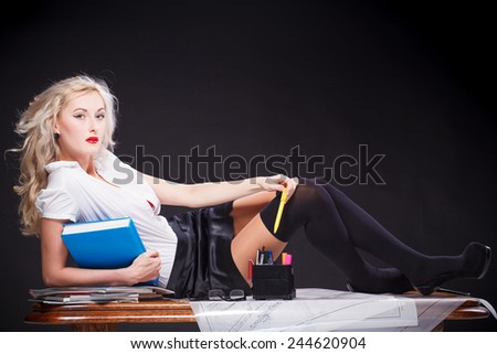 Young sexy teacher - stock photo