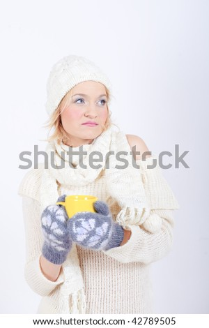 Young sexy winter woman in knit clothes with cup of hot chocolate