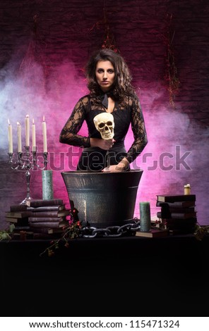 Young sexy witch making the witchcraft in the dungeon - stock photo