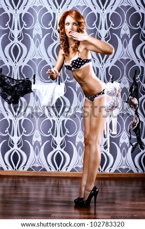 Young sexy woman drying the linen. Pin-up style. - stock photo