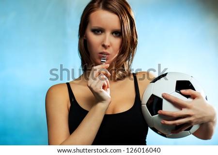 Young sexy woman football referee. - stock photo