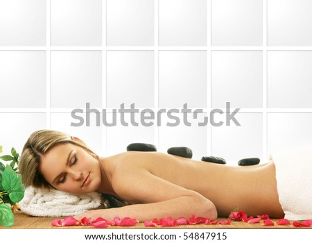Young sexy woman getting spa treatment - stock photo