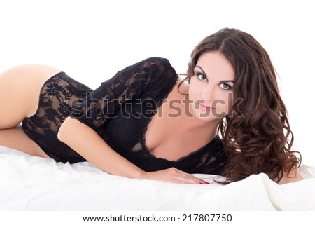 young sexy woman in black lace lingerie lying on bed isolated on white background - stock photo