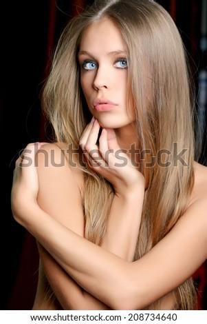 Young sexy woman in dark studio - stock photo