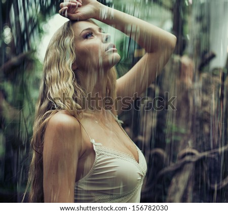 Young sexy woman in jungle - stock photo