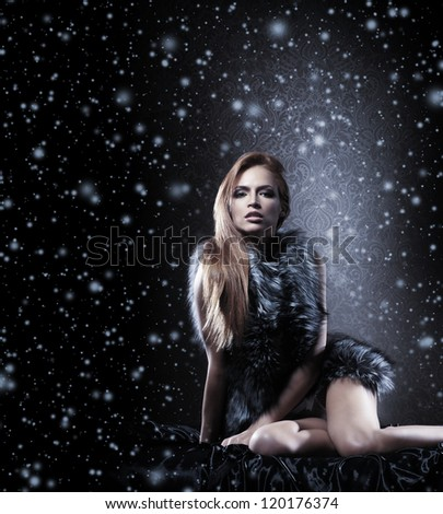 Young sexy woman in lingerie over vintage  snowy background - stock photo