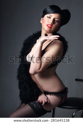 young sexy woman in lingerie .  studio photography,  stylish hairstyle and make-up, bright emotions - stock photo