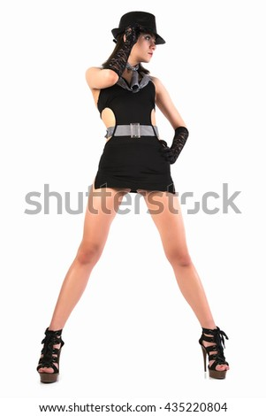 Young sexy woman in the black hat on grey background.  - stock photo