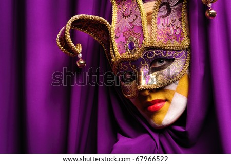 young sexy woman in violet mask open curtain