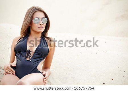 Young sexy woman on beach portrait.  - stock photo