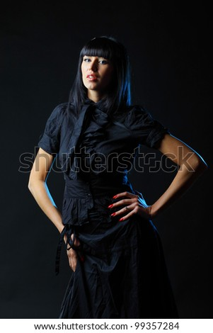Young sexy woman on dark background - stock photo