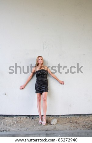 Young sexy woman on the wall background