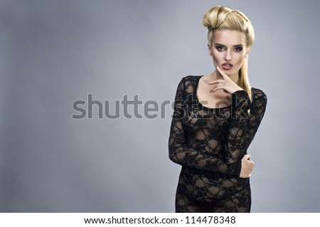 Young sexy woman on wall background portrait. - stock photo