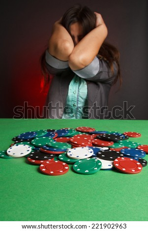 young sexy woman playing poker. Emotions, loss.