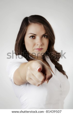 young sexy woman pointing her finger at camera - stock photo