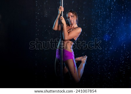 Young sexy woman pole dancer. Water studio photo  - stock photo