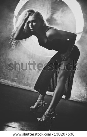 Young sexy woman portrait. Black and white film style colors. - stock photo