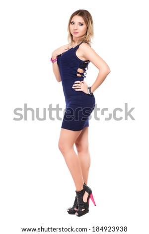 Young sexy woman posing in frank blue dress. Isolated on white - stock photo