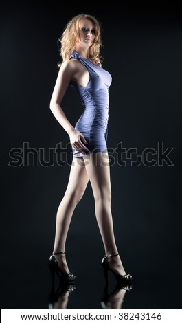 Young sexy woman side view. On dark background. - stock photo