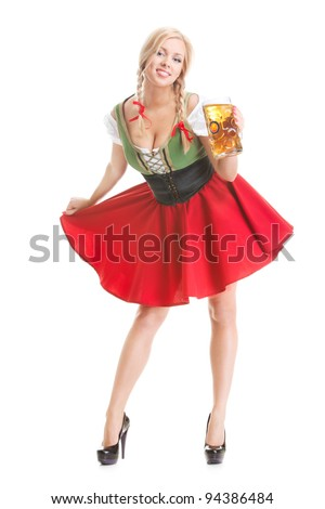young sexy woman wearing a dirndl with beer mug over white - stock photo