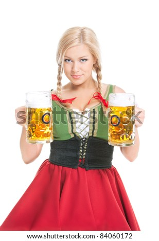young sexy woman wearing a dirndl with two beer mugs over white - stock photo