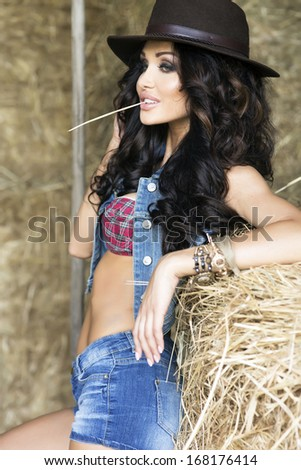 Young sexy Woman wearing cowboy hat, posing. - stock photo