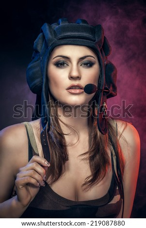 young sexy woman wearing helmet with microphone. military style