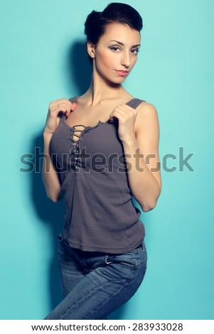 Young sexy woman wearing jeans - stock photo
