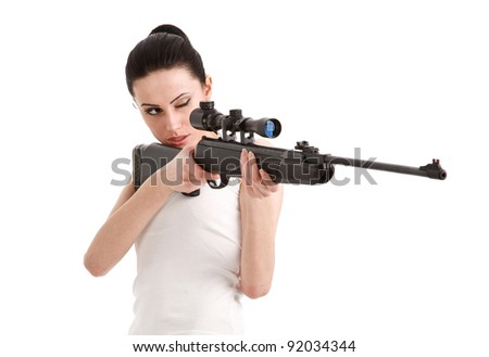 Young sexy woman with a sniper rifle, isolated white background.
