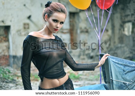 Young sexy woman with balloons