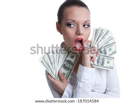young sexy woman with bundle of money wipe a mouth - stock photo