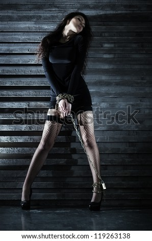 Young sexy woman with chain. - stock photo