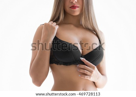 Young sexy woman with long hair demonstrate her black undies.
