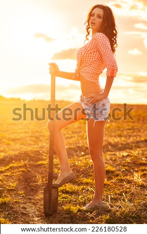 Young sexy woman with shovel. - stock photo