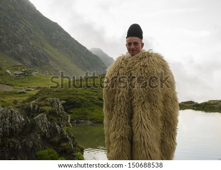 Young shepherd in the mountains - stock photo