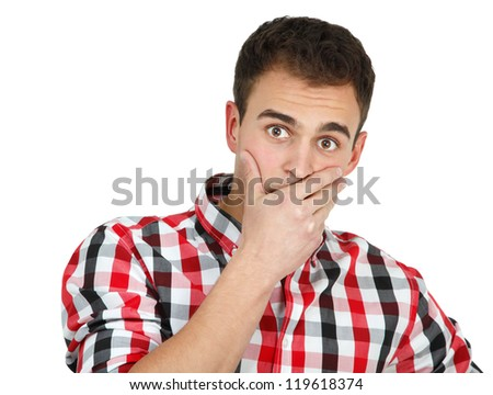 Young shocked man in checked shirt, portrait of attractive guy looking at camera with fear over white background - stock photo