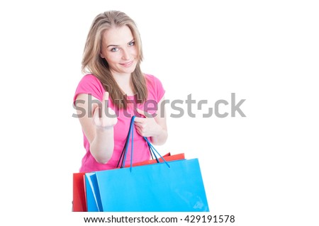 Young shopaholic doing a rude gesture while doing shopping in her leisure isolated on white with copy space - stock photo