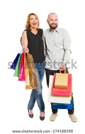 Young shopping couple or boyfriend and girlfriend standing on white background - stock photo