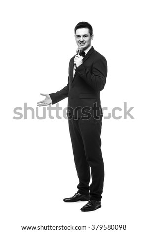 Young Showman present invisible product or advertising  with microphone against white background.Showman concept.