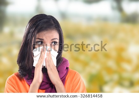 Young sick woman having cold with bedroom background