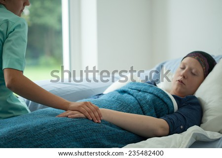 Young sick woman sleeping in her bed - stock photo