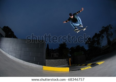 Young skateboarder jumping off a ledge