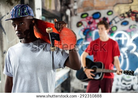 Young skater ready to show his skills in an urban place - stock photo