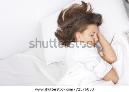 young sleeping woman in bed